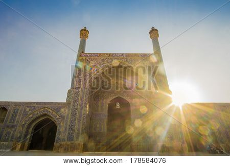 Shah mosque in Isfahan in backlight of the sun