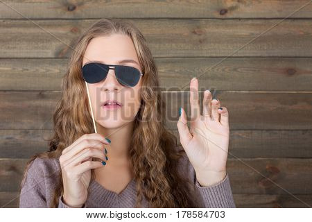 Playful girl represents the blind person