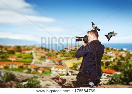 Photographer takes pucture standing on mountain
