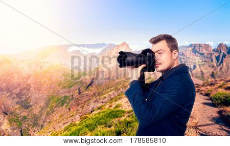 Photographer taking picture of rocky mountains