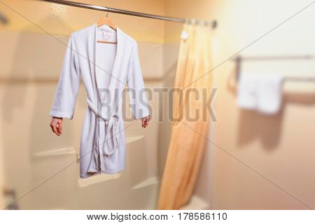 Invisible woman hanging on a hanger in bathroom