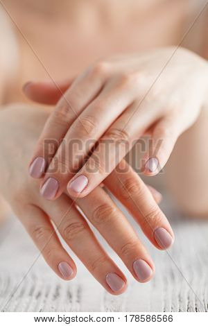 Woman Applies Cream On Her Hands After Bath. Focus On Hands
