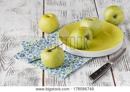 Fresh Greenish Apples In A Dish On A Rustic Background.