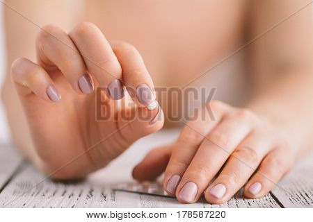 woman in underwear holding contraceptive solutions closeup view