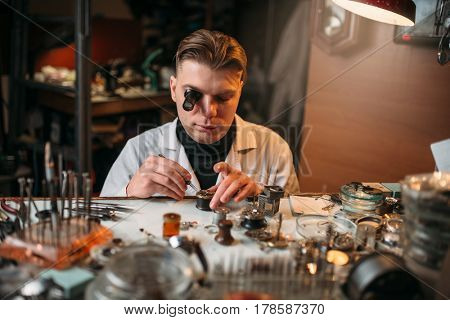 Watchmaker repair old clocks gear