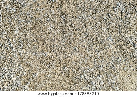 Sand with rubble on the road texture background