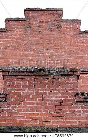 Crumbling Red Brick Wall on an abandoned building