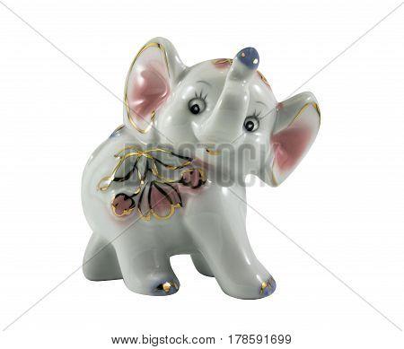 Isolated white porcelain elephant statuette toy photo.