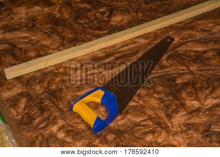 saw with thermal insulation wool and wooden stick