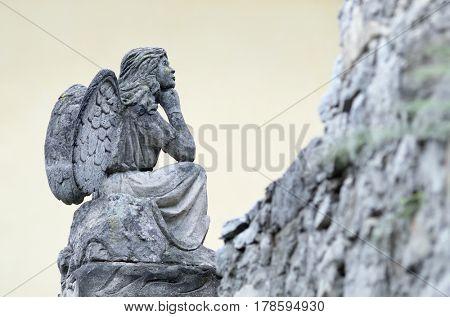 Old sculpture of an angel near the Catholic Church in Kamenets-Podolsky, Ukraine, Europe