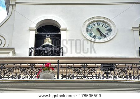 Bell and clock on the facade of a government building, in Quito Ecuador, Southamerica.