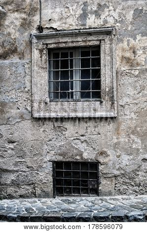Old window of an abandoned house in Italy