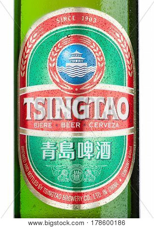 LONDONUK - MARCH 23 2017 : Bottle label of Tsingtao beer on white background.Tsingtao is China's second largest brewery it was founded in 1903 by German settlers.