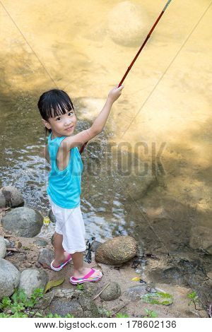 Happy Asian Chinese Little Girl Angling With Fishing Rod