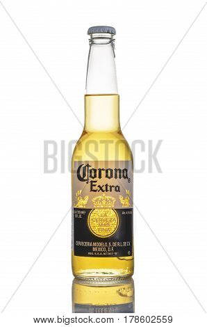 MINSK BELARUS - MARCH 27 2017: Editorial photo of bottle of Corona Extra Beer over white background. Corona is produced by Grupo Modelo with Anheuser Busch InBev.