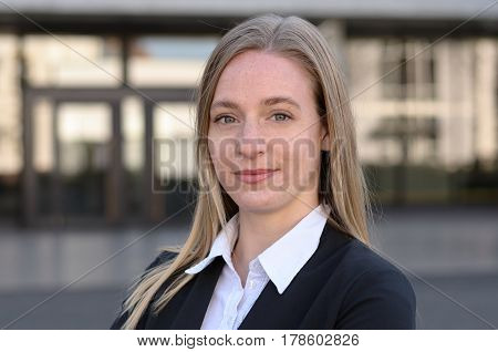 Single Blond Professional Woman Smiling Outside