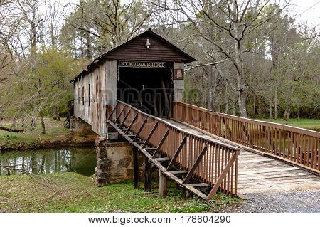 Childersburg Alabama USA - March 25 2017: Kymulga Covered Bridge spanning Talladega Creek. One of two surviving original covered bridges from the Civil War in eastern Alabama.