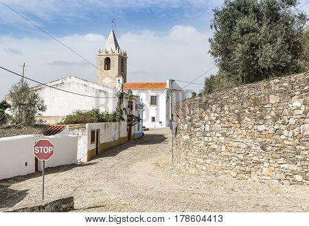 a street and the tower bell in Cabeco de Vide town, Fronteira, Portalegre District, Portugal
