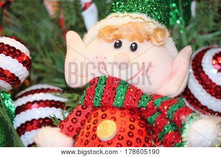 Homemade Elf Doll on a Decorated Christmas Tree