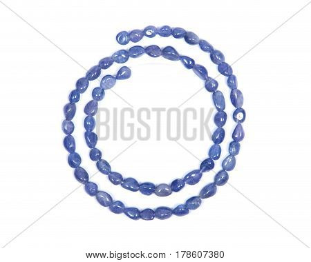 Soft blue violet tanzanite extra quality beads isolated on white background
