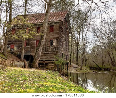 Childersburg Alabama USA - March 25 2017: Springtime at the Kymulga Grist Mill on the banks of Talledega Creek which is original to Civil War period.