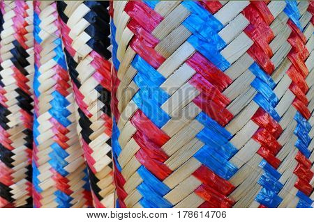 Colourful blue black red and brown abstract natural hand woven texture background.