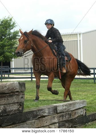 Boy Riding Obstacle Course
