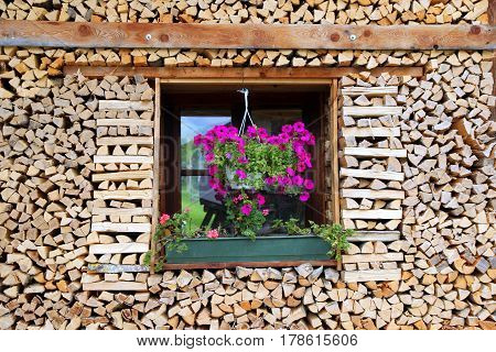 Travel to Sankt-Wolfgang Austria. The window with the flowers at the wooden house.