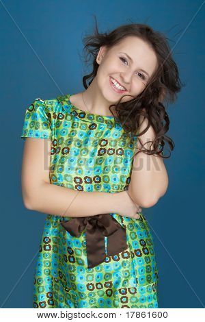 Happy Young Woman With Long And Curly Hair