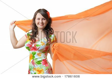 Young woman with peach-pink fabric