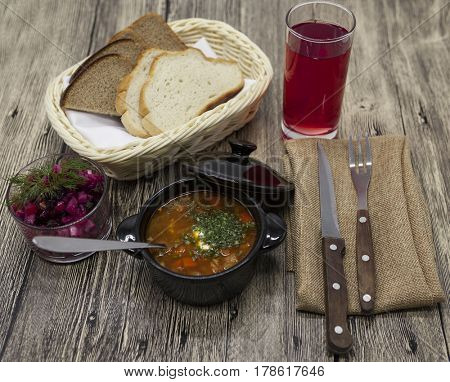 Rustic lunch of tomato soup with beef, beet salad on the table