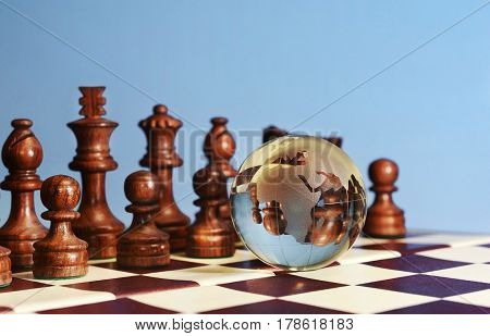 Chess Figures Against Earth Globe