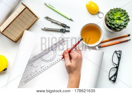 profession concept with architect desk and constructor tools and hands on white background top view