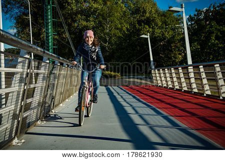 Girl biking in city