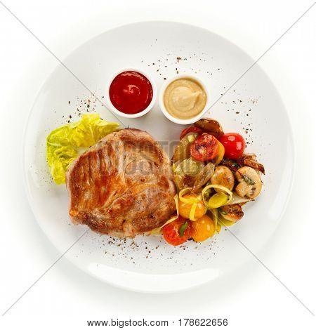 Roast steak on white plate