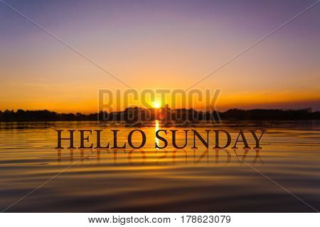 'HELLO SUNDAY ' with sunset water , twilight time