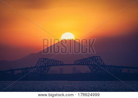 Diamond Fuji View of the setting sun meeting the summit of Mt. Fuji