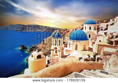 Amazing Santorini over sunrise. View of Oia village with famous blue churches