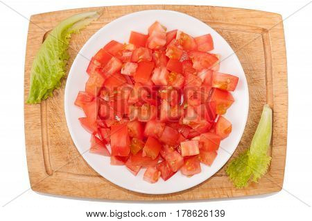 Vegetables on white background. Tomato greens cutting board plate on a white background. Vegan. Healthy eating. Cutting vegetables on a board. Cutting