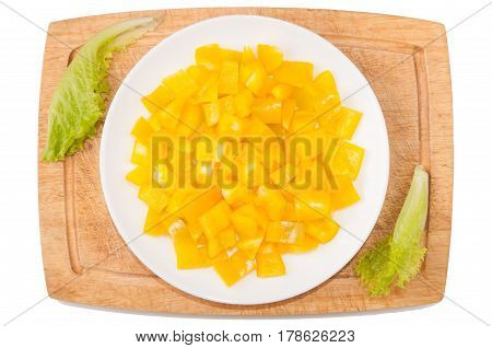 Vegetables on white background. Bell pepper greens cutting board plate on a white background. Vegan. Healthy eating. Cutting vegetables on a board. Cutting