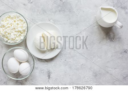 fresh dairy products for proteic meal on grey table background top view mockup