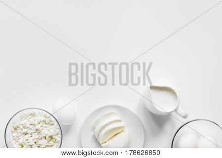 fresh dairy products for proteic meal on white table background top view mock up