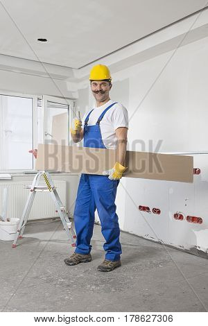 Construction Worker with Mustache Carrying Wood