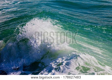 Crashing wave in a stormy ocean