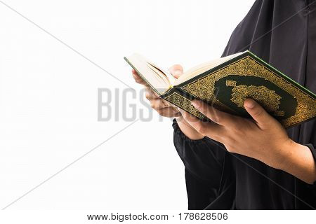 Koran in hand - holy book of Muslims( public item of all muslims )Koran in hand muslims woman