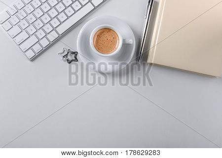 Modern workplace with cup of coffee