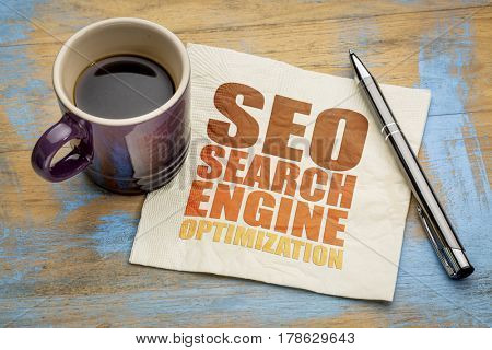 SEO search engine optimization word abstract  on a napkin with a cup of espresso coffee