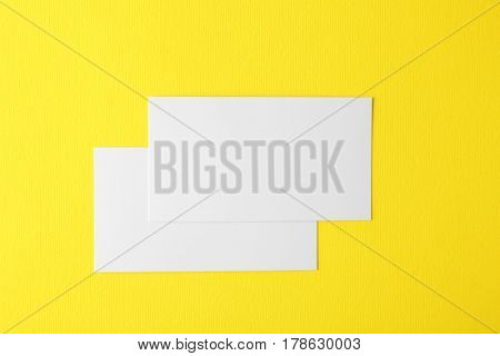 Blank business cards on yellow background
