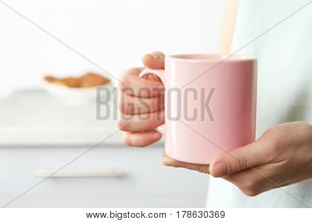 Closeup view of woman holding cup