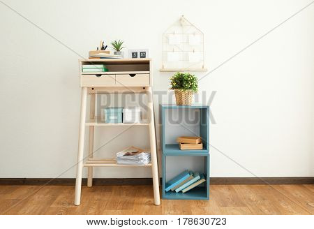 High wooden table as stand up work place in modern interior
